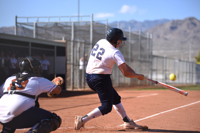 Shadow Ridge's Kate Dennis (22) hits a pitch against Legacy during their softball game at Shadow Ridge High School in Las Vegas on Wednesday April 15, 2015. (Martin S. Fuentes/Las Vegas Review-Jou ...