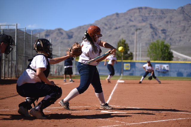 Legacy's Alyssa Gastelum (14) swings at a pitch against Shadow Ridge during their softball game at Shadow Ridge High School in Las Vegas on Wednesday April 15, 2015. (Martin S. Fuentes/Las Vegas R ...