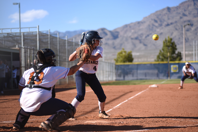 Shadow Ridge's Sophie Meza (4) looks at a pitch against Legacy during their softball game at Shadow Ridge High School in Las Vegas on Wednesday April 15, 2015. (Martin S. Fuentes/Las Vegas Review- ...