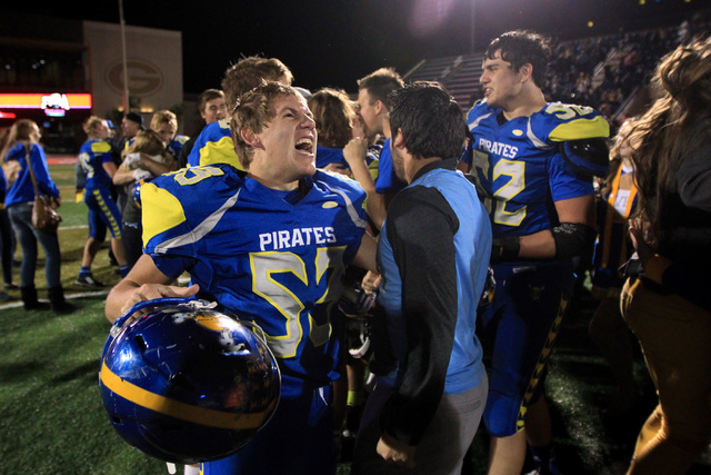 Moapa Valley players celebrate their 42-36 overtime win over Desert Pines in the Division I-A state championship game. (Sam Morris/Las Vegas Review-Journal)