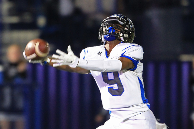 A pass is just out of reach for Desert Pines wide receiver Andre Watts on their final drive during the Division I-A championship game against Moapa Valley Saturday, Moapa Valley came back and won  ...