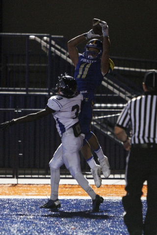 Moapa Valley wide receiver R.J. Hubert pulls in the game-winning touchdown while being covered by Desert Pines cornerback Gianni Breland during the Division I-A championship game Saturday. Moapa V ...