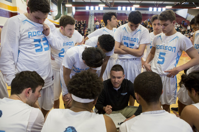 Adelson basketball team huddles for a timeout during the 2A boys state semifinal game at Del Sol High School on Friday, Feb. 24, 2017, in Las Vegas.  (Bridget Bennett/Las Vegas Review-Journal) @br ...