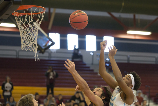 Adelson junior Miles Hagan goes up for a basket during the 2A boys state semifinal game at Del Sol High School on Friday, Feb. 24, 2017, in Las Vegas.  (Bridget Bennett/Las Vegas Review-Journal) @ ...