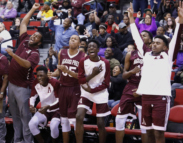 Agassi Prep's players and coaches react during the second half of a Class 2A boys state final at the Cox Pavilion on Saturday, Feb. 25, 2017, in Las Vegas. Agassi Prep defeated Adelson School, 60- ...