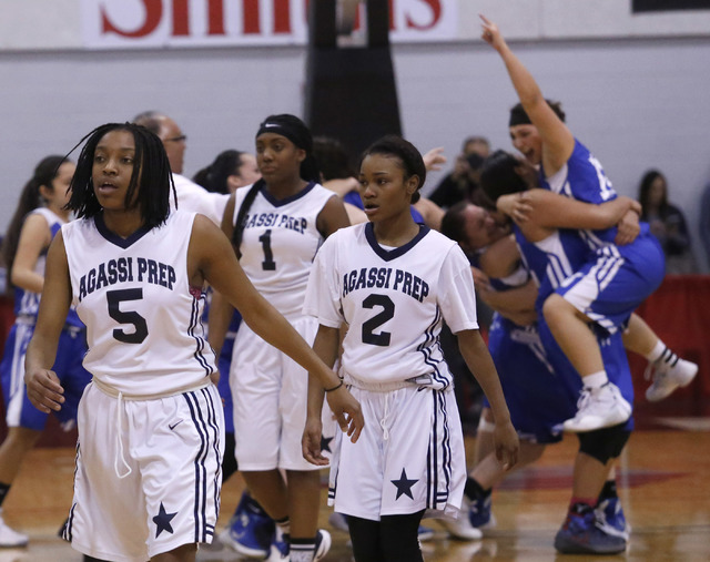 Agassi Prep's Pa'Shun Minter (5), from left, Lovely Glinton (1), and Agassi Prep's Cecilei Dixon (2) walk off the floor after loosing to Needle at a Class 2A girls state final championship game at ...