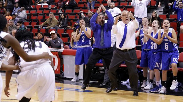 Needle's head coach Manuel Calderon call a time out as his player cheer during the second half of a Class 2A girls state final championship game at the Cox Pavilion on Saturday, Feb. 25, 2017, in  ...