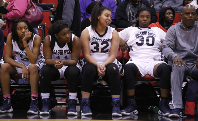 Agassi Prep players react after loosing to Needle at a Class 2A girls state final championship game at the Cox Pavilion on Saturday, Feb. 25, 2017, in Las Vegas. Needle won 64-54. (Christian K. Le ...