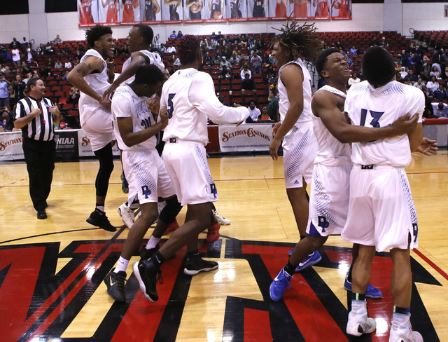 Desert Pines players react after winning a Class 3A boys state final championship game at the Cox Pavilion on Saturday, Feb. 25, 2017, in Las Vegas. Desert Pines won 69-46. (Christian K. Lee/Las V ...