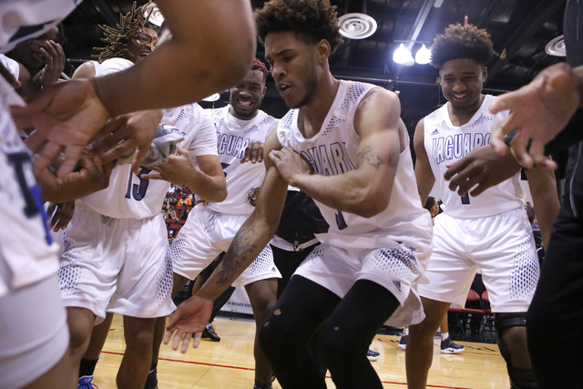 Cheyenne's Marcus Greer (3) dances as his teammates cheer him on after winning a Class 3A boys state final championship game at the Cox Pavillion on Saturday, Feb. 25, 2017, in Las Vegas. Desert P ...