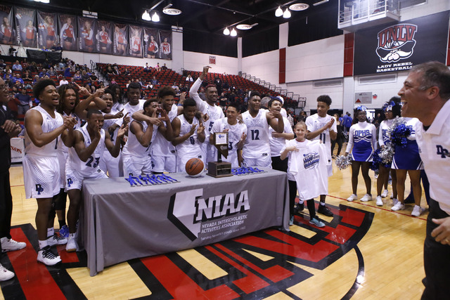 Desert Pines players react after winning a Class 3A boys state final championship game at the Cox Pavillion on Saturday, Feb. 25, 2017, in Las Vegas. Desert Pines won 69-46. (Christian K. Lee/Las  ...