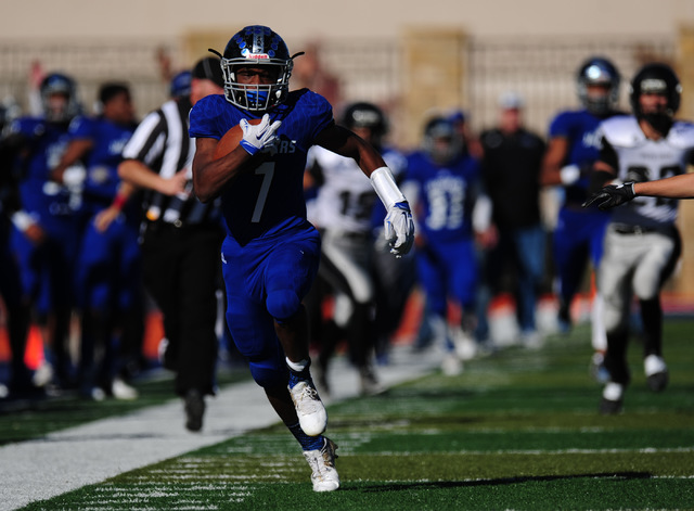 Desert Pines running back Isaiah Morris rushes for a first down against Spring Creek in the first half of the NIAA Class 3A State championship game at Bishop Gorman High School in Las Vegas Saturd ...