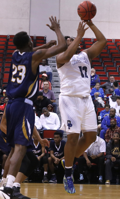 Cheyenne's Jaiden Martin (12) over Desert Pine's Donovan Word (23) during the first half of a Class 3A boys state final championship game at the Cox Pavilion on Saturday, Feb. 25, 2017, in Las Veg ...