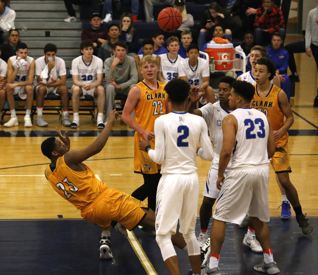 Clark's Antwon Jackson (23) shots as he is falling during the first half of a Class 4A Sunset Region championship boys basketball game on Saturday, Feb. 18, 2017, in North Las Vegas. (Christian K. ...