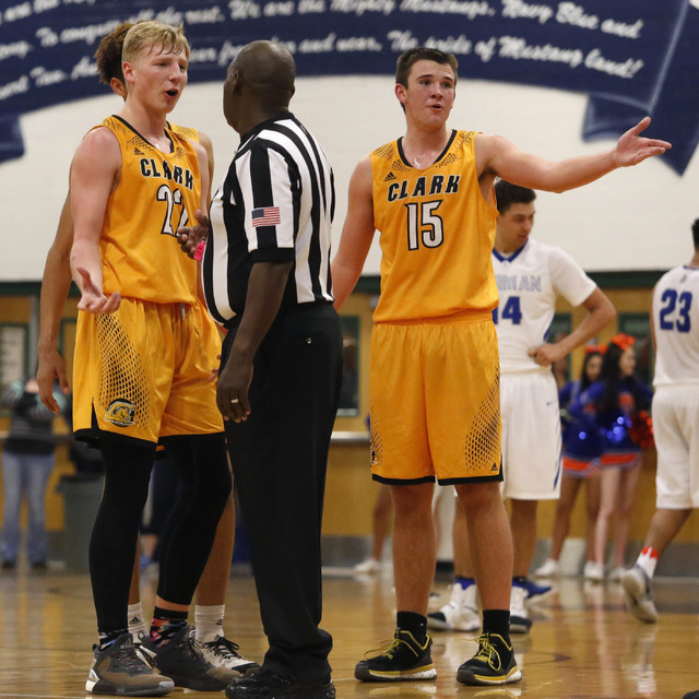 Clark's Trey Woodbury (22) and Clark's James Bridges (15) speaks with the referee during the second half of a Class 4A Sunset Region championship boys basketball game on Saturday, Feb. 18, 2017, i ...