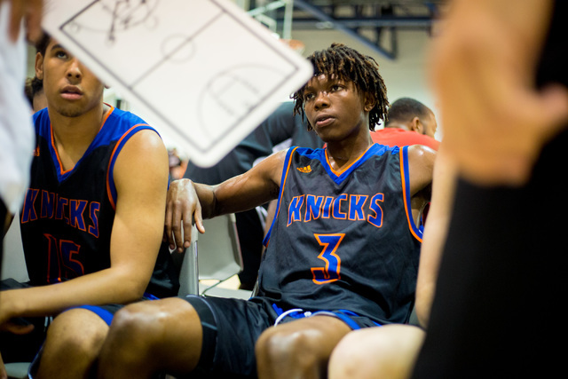 Las Vegas Knicks guard Isaiah Banks listens as plays are discussed during a game against the Iowa Brainstorms in an adidas Uprising Summer Championship game at the Cashman Center, Las Vegas, Wedne ...