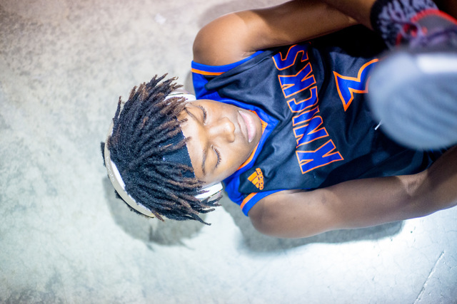 Las Vegas Knicks guard Isaiah Banks stretches before playing Iowa Brainstorms in an adidas Uprising Summer Championship game at the Cashman Center, Las Vegas, Wednesday night, July 20, 2016. (Eliz ...