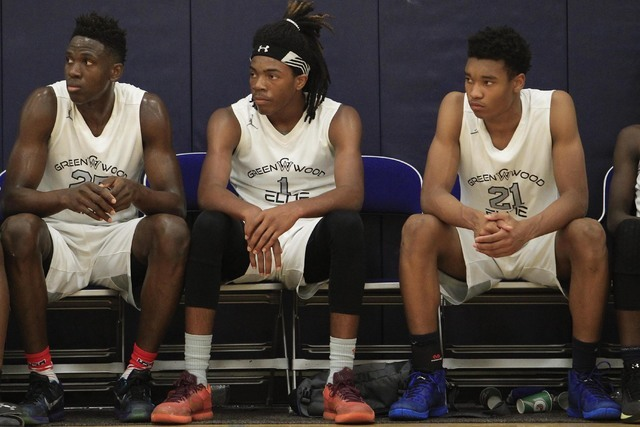 Greenwood Elite's Terry Armstrong (1) is seen on the bench against Costal Elite during the Las Vegas Fab Forty 8 U17 Invitational championship games on the final day of the AAU tournaments at Bi ...