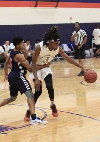 Greenwood Eliteճ Terry Armstrong (1) drives the ball against Costal Elite during the Las Vegas Fab Forty 8 U17 Invitational championship games on the final day of the AAU tournaments.(Richard Bri ...