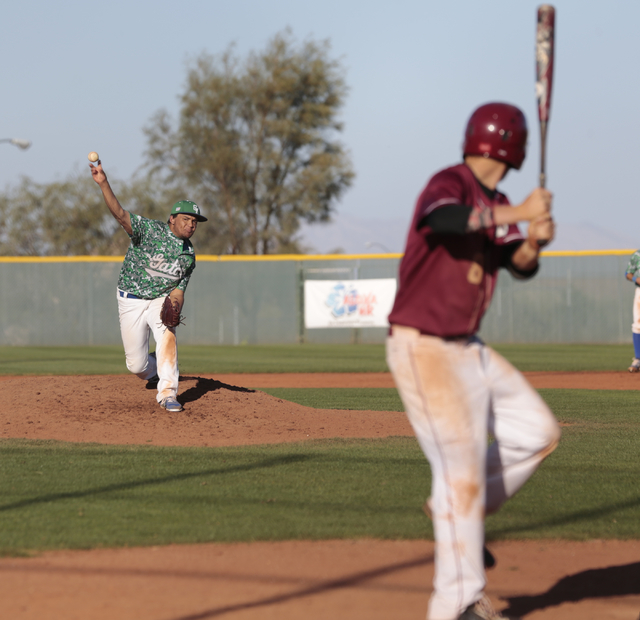 Green Valley junior Noah Wise (13) delivers a pitch to Desert Oasis senior Chase Adams (8) during the championship game of the Lions Kickoff Tournament at Desert Oasis on Saturday. Wise threw 4 2/ ...