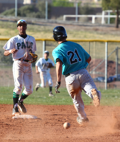 Silverado's Dillon Johnson (21) heads to second base as Palo Verde's Will Hamilton (3) looks on Friday. Silverado won the game 11-8. (Chase Stevens/Las Vegas Review-Journal)