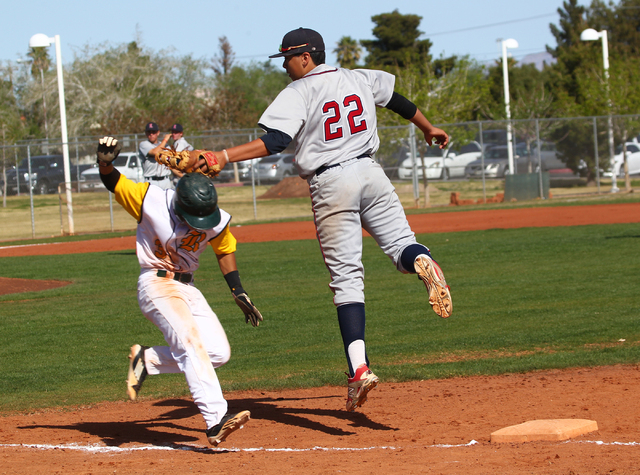 Rancho's Bryce Harrell (3) ducks under the tag of Liberty's Omar Ortiz (22) during Saturday's game. (Chase Stevens/Las Vegas Review-Journal)