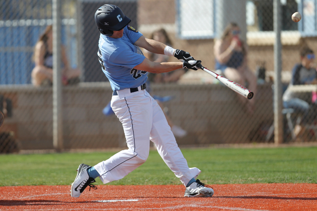 Centennial's Jake Portaro (24) connects with the ball in their baseball game against Legacy at Centennial High School in Las Vegas Monday, March 16, 2015. Centennial won 10-0 in the fifth inning b ...