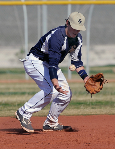 Shadow Ridge shortstop Brady Hoskins bobbles on Monday against Coronado. Hoskins recovered to make the play, and the Mustangs won, 8-4. (David Becker/Las Vegas Review-Journal)