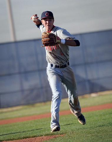 Coronado third baseman Tanner Bellamy sets up to throw the ball to first base during a game against Shadow Ridge on Monday. (David Becker/Las Vegas Review-Journal)