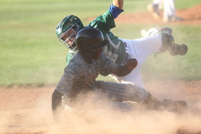Bonanza's Andre Isaraq (4) slides into home against Green Valley on Friday. (Chase Stevens/Las Vegas Review-Journal)