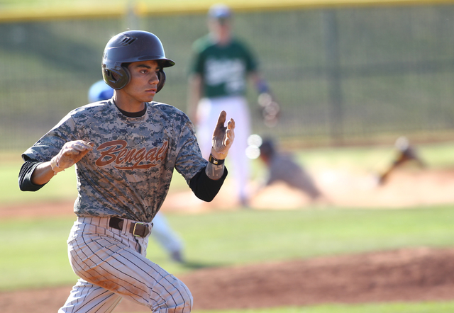Bonanza's Cruz Nevarez (2) runs for first base against Green Valley on Friday. (Chase Stevens/Las Vegas Review-Journal)