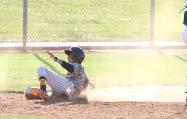 Bonanza's Cruz Nevarez (2) slides into home against Green Valley on Friday. (Chase Stevens/Las Vegas Review-Journal)