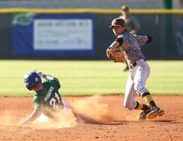 Bonanza's Cruz Nevarez (2) looks to to turn a double play after forcing Green Valley's Garrett Rogers (21) on Friday. (Chase Stevens/Las Vegas Review-Journal)