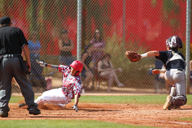 Arbor View's Justin Rivera slides into home plate against Faith Lutheran on Saturday. The Aggies won, 6-2. (Chase Stevens/Las Vegas Review-Journal)