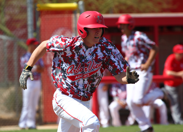 Arbor View's Sam Pastrone runs for first base against Faith Lutheran last season. The senior has signed with UNLV and should be one of Arbor View's top hitters and pitchers. (Chase Stevens/Las Veg ...