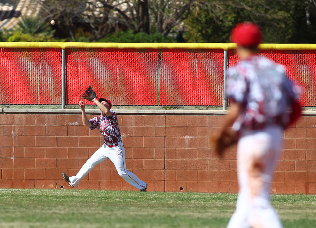 Arbor View's Kevin Johns catches a fly ball off the bat of Faith Lutheran's Zach Trageton for the second out of the seventh inning on Saturday. Arbor View won, 6-2. (Chase Stevens/Las Vegas Review ...
