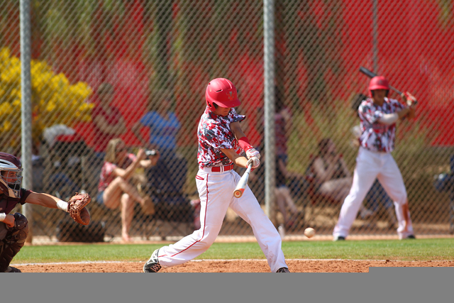 Arbor View's Max Jungblut takes a hack against Faith Lutheran on Saturday. Arbor View won 6-2. (Chase Stevens/Las Vegas Review-Journal)