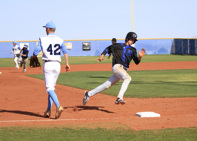 Basic High School junior David Hudleson (5) heads around third base on the way to home plate during a game against Centennial High School at the Centennial baseball field, 10200 W. Centennial Pkwy ...