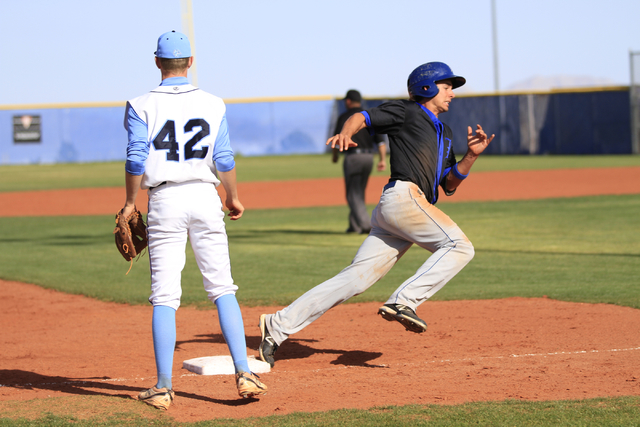 Basic High School senior Logan Green (4) rounds third base on his way to home during a game against Centennial High School at the Centennial baseball field, 10200 W. Centennial Pkwy., Las Vegas,   ...