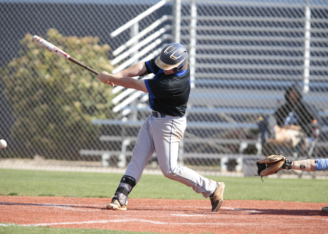 Basic High School sophomore Jack Wold (19) takes a wide swing during a game against Centennial High School at the Centennial baseball field, 10200 W. Centennial Pkwy., Las Vegas,  on Tuesday, Apri ...