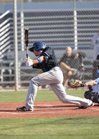 Basic High School senior Logan Green (4) connects on his swing during a game against Centennial High School at the Centennial baseball field, 10200 W. Centennial Pkwy., Las Vegas,  on Tuesday, Apr ...