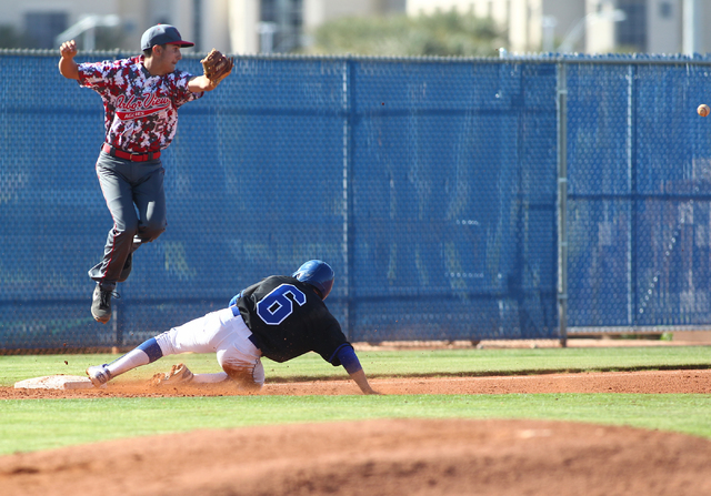 Sierra Vista's Cole Crosby (6) slides into third base as the throw sails past Arbor View's Quinn Gallagher (2) in the third inning on Thursday. Arbor View won, 6-5. (Chase Stevens/Las Vegas Review ...