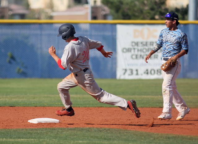 Coronado's Anthony Olheiser, left, runs past Centennial's Jaycob DelBarrio at second during a baseball game against at Centennial High School Friday, April 24, 2015, in Las Vegas. (Ronda Churchill ...