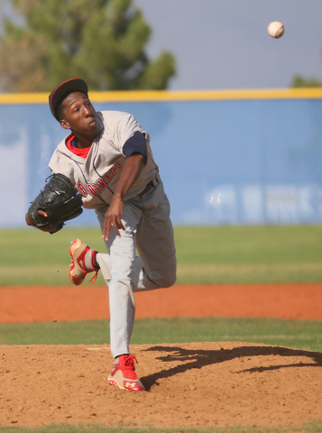 Coronado's Donte Glover pitches and his hat lifts in the wind during a baseball game against Centennial at Centennial High School Friday, April 24, 2015, in Las Vegas. (Ronda Churchill/Las Vegas R ...
