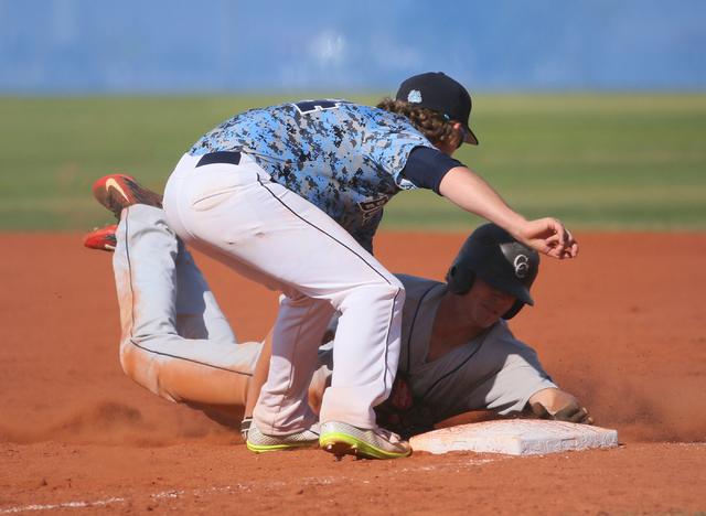 Centennials' Jordon Wyke, left, tags out  Coronado's Jacen Yergensen at first base during a baseball game at Centennial High School Friday, April 24, 2015, in Las Vegas. (Ronda Churchill/Las Vegas ...