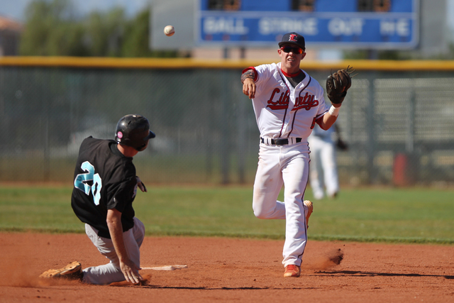 Liberty's Nick Rush (5) throws to first base for a double play against Silverado in their baseball game at Liberty High School in Henderson Monday, April 27, 2015. Liberty won 4-1. (Erik Verduzco/ ...