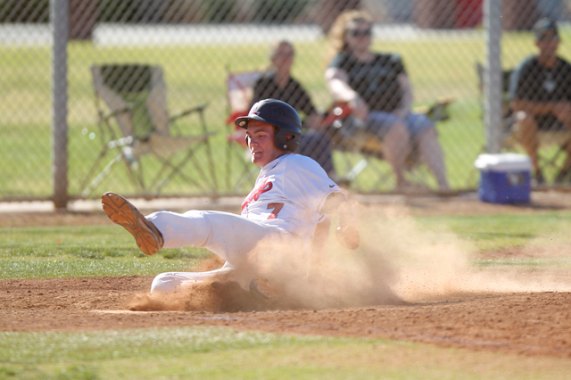 Liberty's Trevor Mullaney (7) slides home for a run against Silverado in their baseball game at Liberty High School in Henderson Monday, April 27, 2015. Liberty won 4-1. (Erik Verduzco/Las Vegas R ...