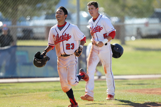 Liberty's Jonny Gilleres (23) runs home after hitting a two-run home run against Silverado in their baseball game at Liberty High School in Henderson Monday, April 27, 2015. Liberty won 4-1. (Erik ...