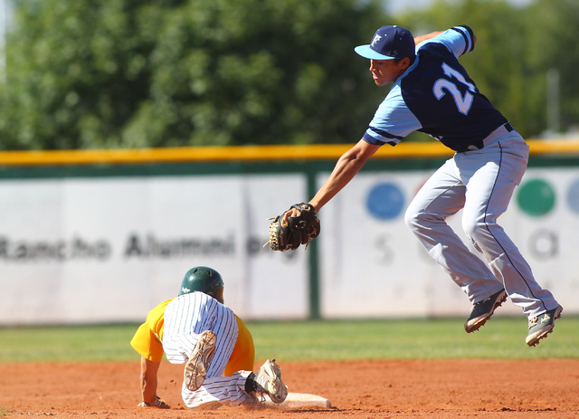 Rancho's Braulio Santiaguin slides under the tag of Foothill shortstop Tyler Van Stone (21) during the second inning Friday. Rancho won, 13-3. (Chase Stevens/Las Vegas Review-Journal)