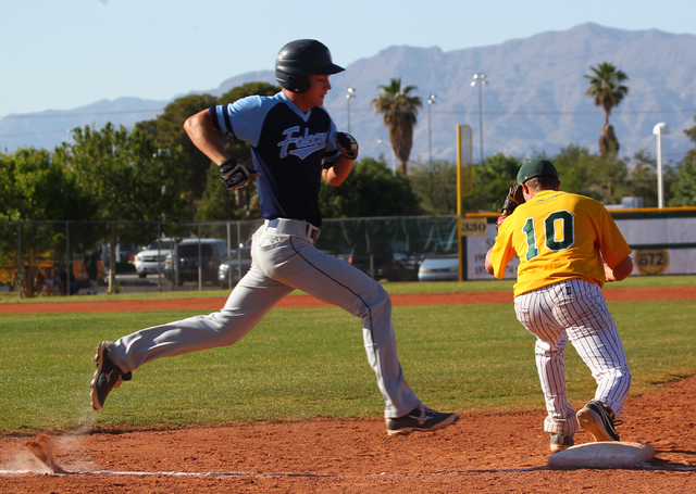 Foothill's Jack Fredericksen, left, runs to first base as Rancho's Josh Mill (10) fields the throw for the first out of the fifth inning Friday. Rancho won, 13-3. (Chase Stevens/Las Vegas Review-J ...